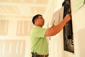 Building Inspector checking wires