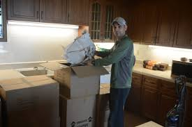 Man packing things in boxes